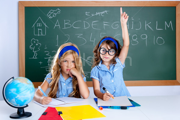 clever nerd student girl in classroom raising hand Stock photo © lunamarina