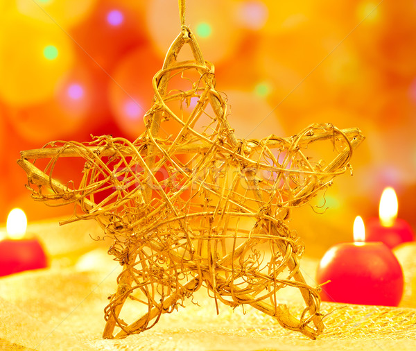 Christmas golden star candles in blurred lights Stock photo © lunamarina