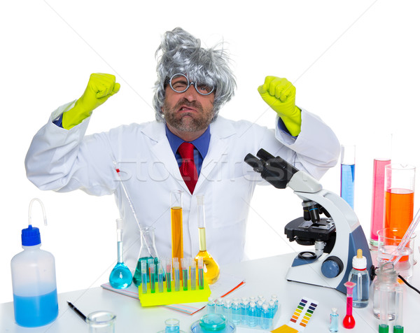 Stock photo: Crazy mad nerd scientist funny expression at lab