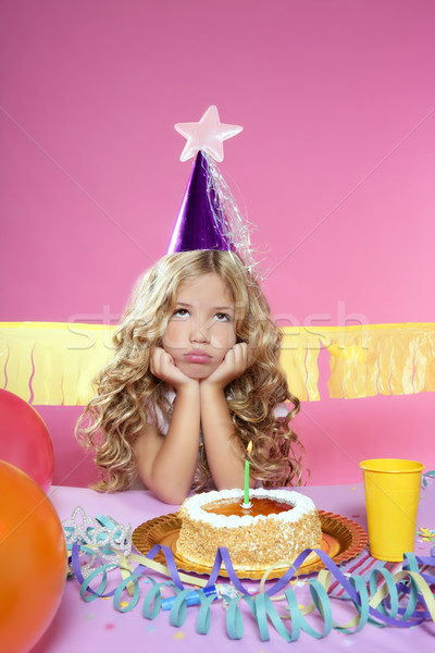 bored little blond girl birthday party with candle cake Stock photo © lunamarina