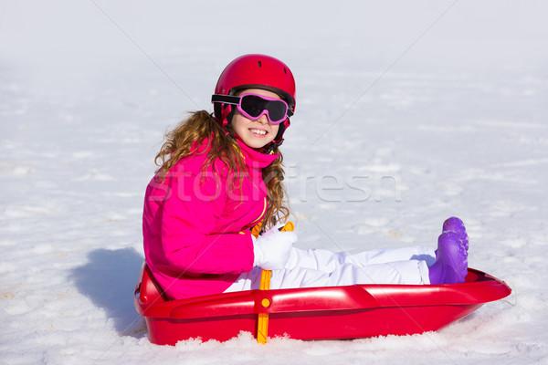 Kid girl playing sled in winter snow Stock photo © lunamarina