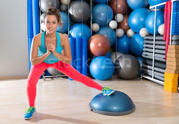 bosu one leg squat girl exercise at gym workout Stock photo © lunamarina