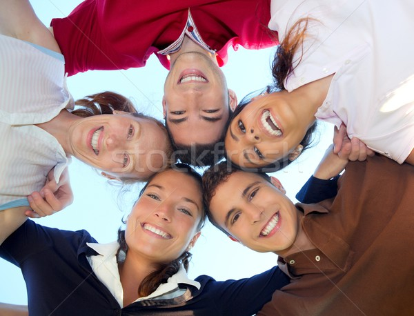 friends happy group in circle heads from below Stock photo © lunamarina