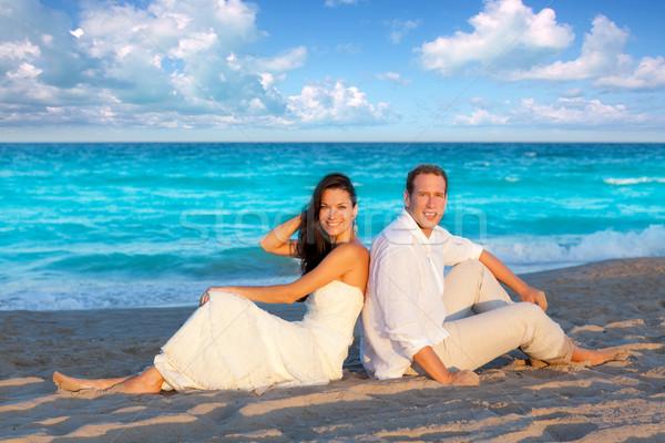 couple in love sitting in blue beach Stock photo © lunamarina