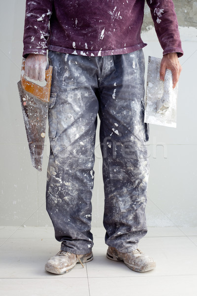 construction plaster plaster man dirty trousers Stock photo © lunamarina