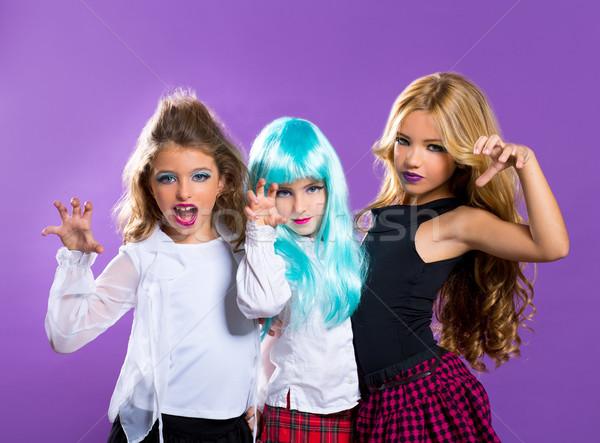 children group of fashiondoll scaring girls on purple Stock photo © lunamarina