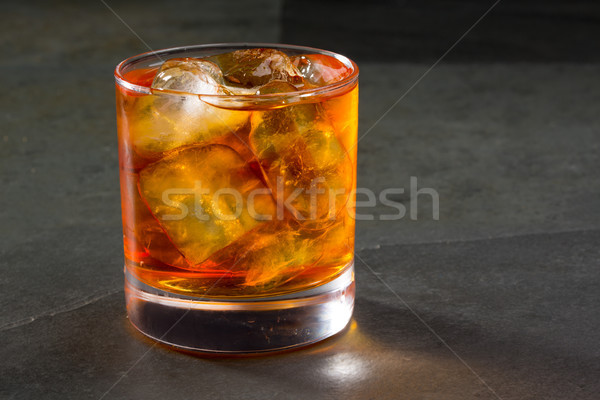 Whiskey whisky on the rocks on glass Stock photo © lunamarina