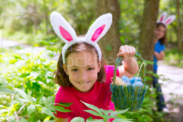Stock photo: Easter girl with eggs basket and funny bunny face