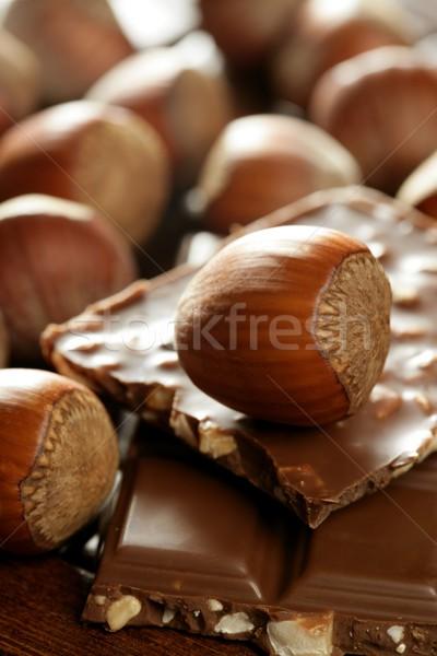 Hazelnuts and chocolate in brown enviroment Stock photo © lunamarina