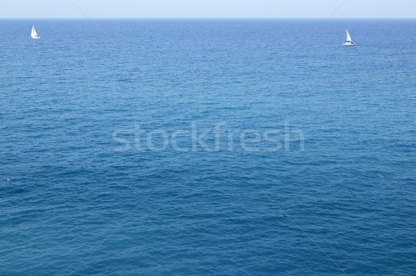 Blue sea with sailboat sailing the ocean surface summer vacation Stock photo © lunamarina
