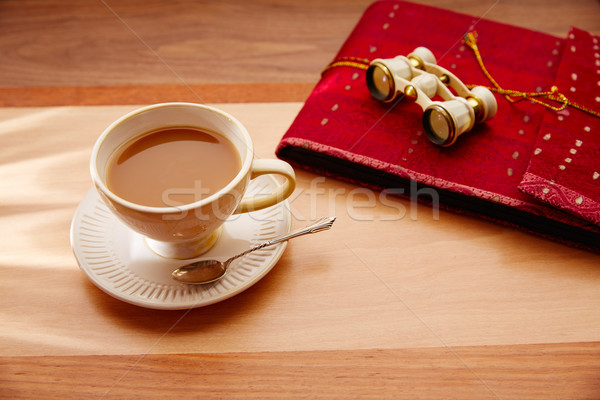 Traveler coffee or milk tea with binoculars and notebook Stock photo © lunamarina