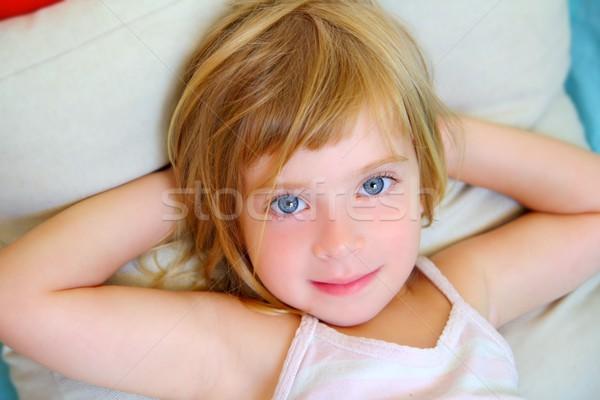 Rubio nina almohada ojos azules sonriendo Foto stock © lunamarina