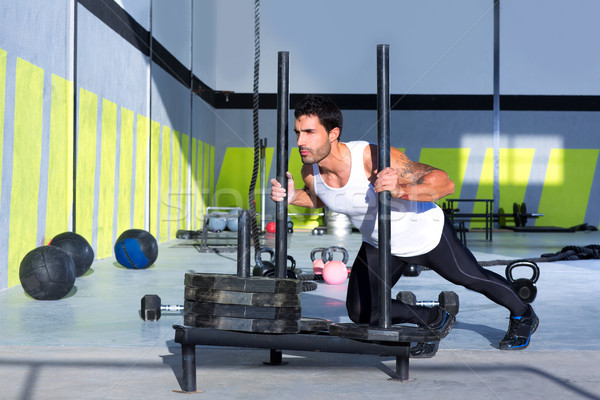 Crossfit sled push man pushing weights workout Stock photo © lunamarina
