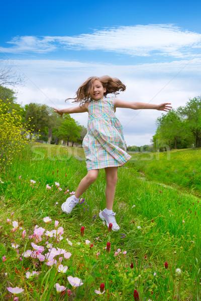 happy children girl jumping on spring poppy flowers Stock photo © lunamarina