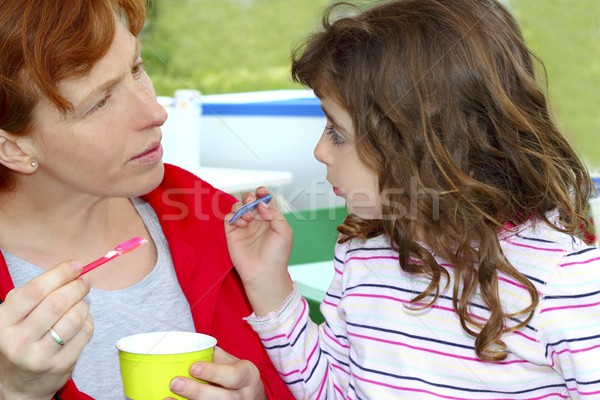 Stock photo: mother and daughter eating ice cream talking