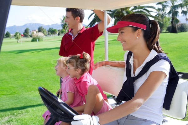 golf course family father mother daughters buggy Stock photo © lunamarina