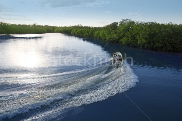 Boat ship wake prop wash sunset lake river Stock photo © lunamarina