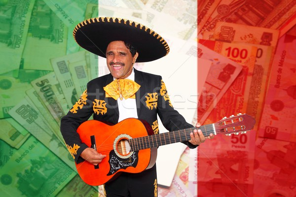 Charro Mariachi playing guitar mexican peso notes Stock photo © lunamarina