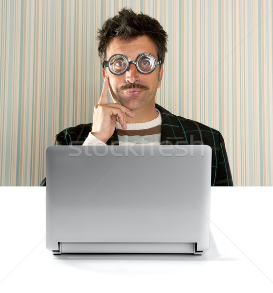Stock photo: Nerd pensive man glasses silly expression laptop