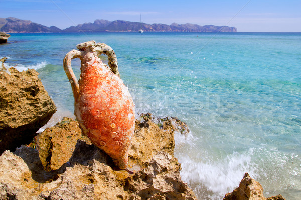 Alcudia Beach Mallorca with roman amphora Stock photo © lunamarina