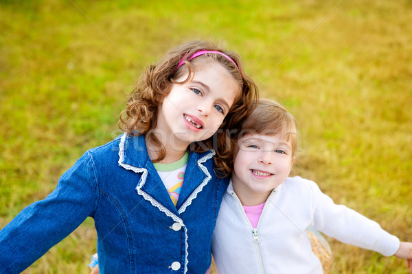 Stock photo: happy sister girls in winter park grass playing