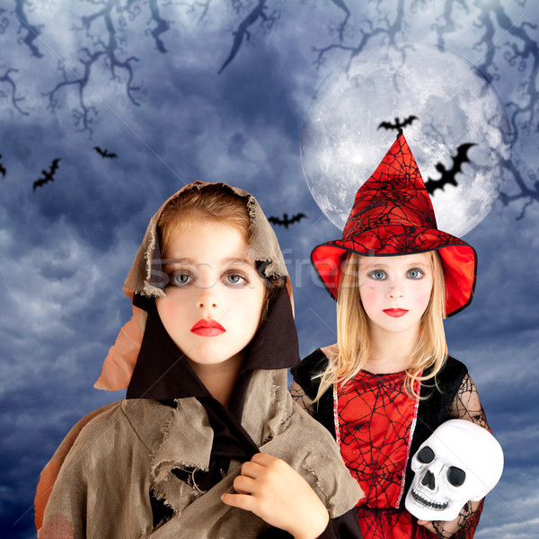 halloween kid girls with skull cloudy moon Stock photo © lunamarina