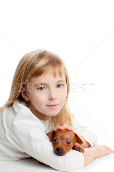 blond kid girl with mini pinscher pet mascot dog Stock photo © lunamarina