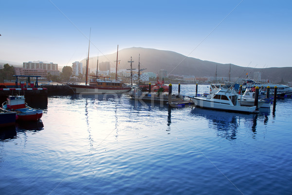 Los Cristianos harbor port sailboat sunrise in Adeje Stock photo © lunamarina