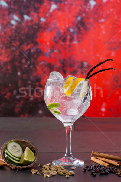 Gin tonic cocktail with spices in red grunge background Stock photo © lunamarina