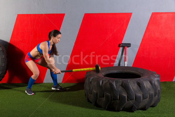 Sledgehammer Tire Hits woman workout at gym Stock photo © lunamarina