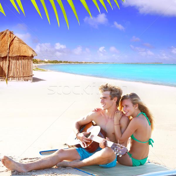 Szőke pár ül tengerparti homok játszik gitár Stock fotó © lunamarina