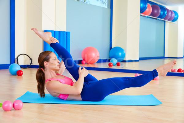 Pilates woman scissor exercise workout at gym Stock photo © lunamarina