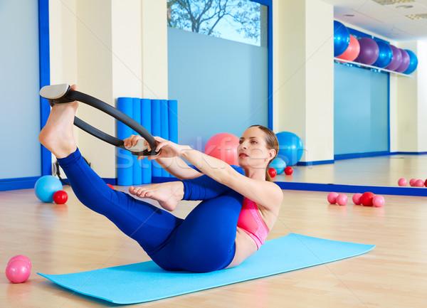 Pilates woman single leg stretch magic ring exercise Stock photo © lunamarina