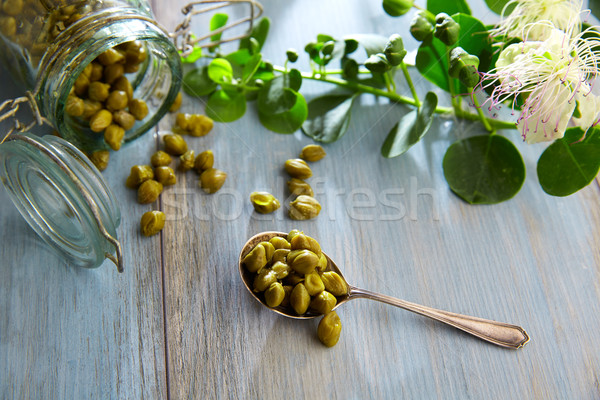 Capers pickled with plant and caper plant flower Stock photo © lunamarina