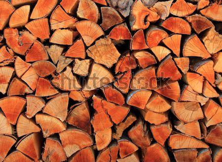 firewood wood pile stacked triangle shape Stock photo © lunamarina