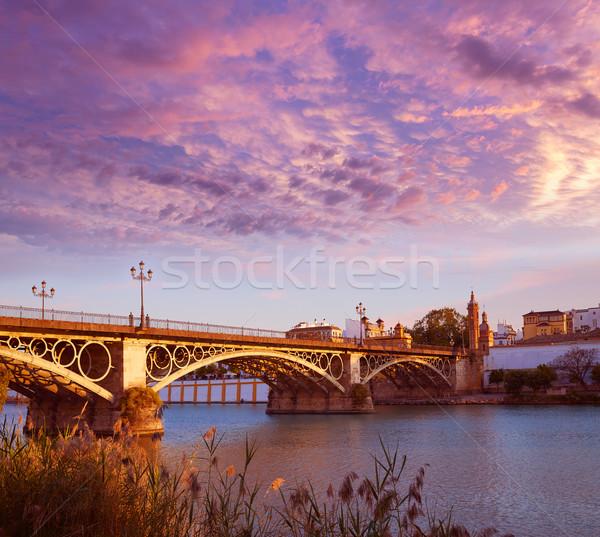 Puente Isabel II bridge sunset in Triana Seville Stock photo © lunamarina