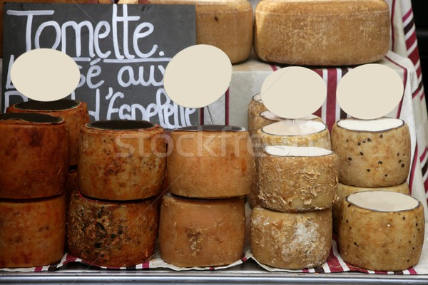 Aged french cheese wheels stacked Stock photo © lunamarina