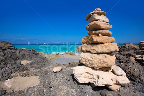 Stone figures on beach shore of Illetes beach in Formentera Stock photo © lunamarina