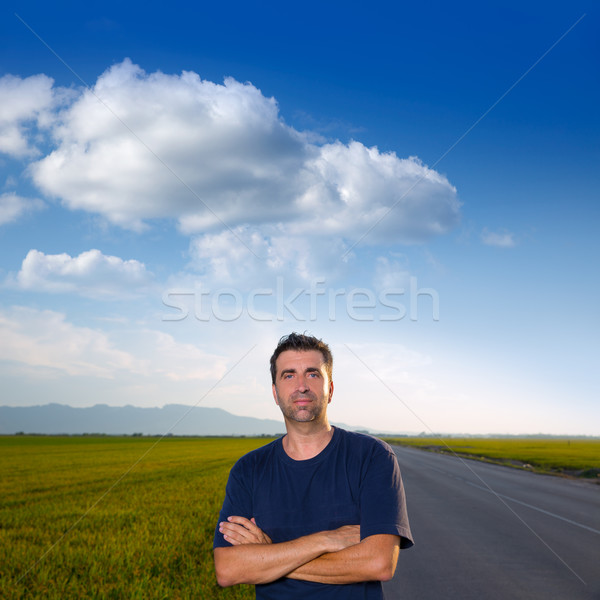 Mid age man in road at meadows posing crossed arms Stock photo © lunamarina