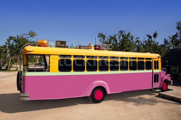 Colorful bus yellow and pink touristic tropical Stock photo © lunamarina