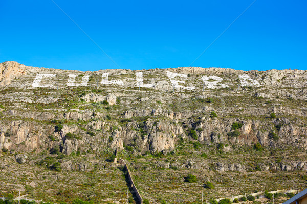 Cullera mountain with white sign writed on in Stock photo © lunamarina