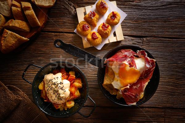 Tapas törött tojások étterem asztal olaj Stock fotó © lunamarina