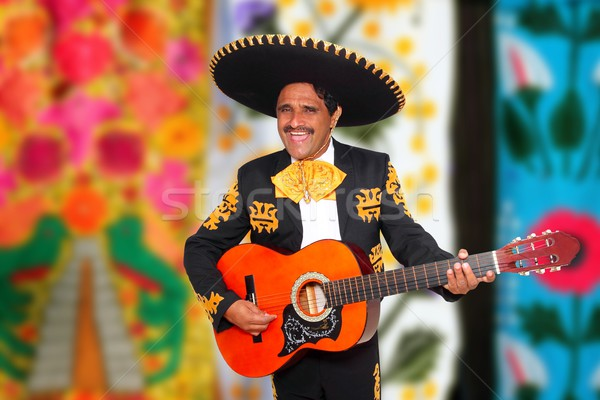 Charro Mariachi playing guitar serape poncho Stock photo © lunamarina