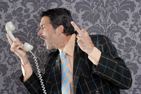 Angry nerd businessman retro telephone call shouting Stock photo © lunamarina