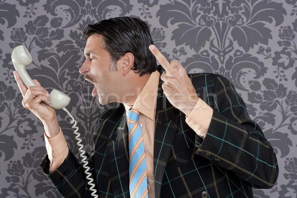 Stock photo: Angry nerd businessman retro telephone call shouting