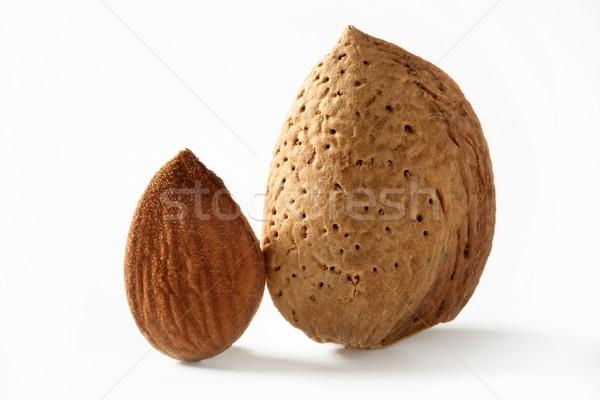 Almond macro image over white background Stock photo © lunamarina