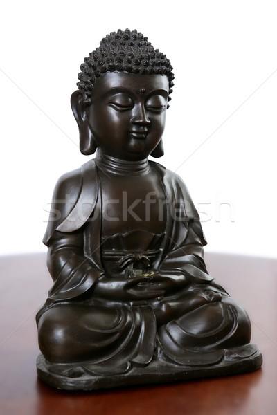 Buda pequeno preto escultura vermelho madeira Foto stock © lunamarina