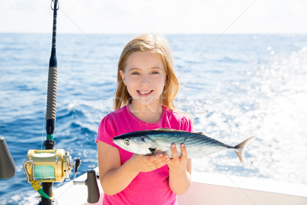 Blond kid girl fishing tuna bonito sarda fish happy catch Stock photo © lunamarina