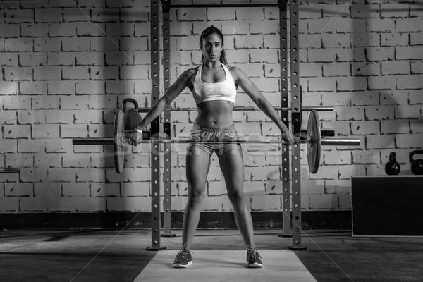 Barbell gewichtheffen vrouw gewichtheffen gymnasium training Stockfoto © lunamarina