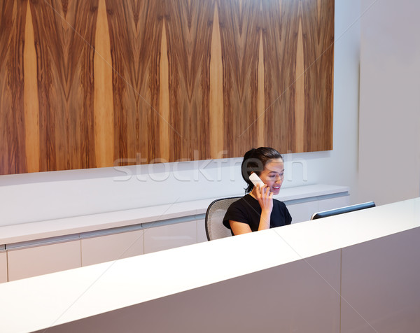 Brunette receptionist young woman in desk Stock photo © lunamarina